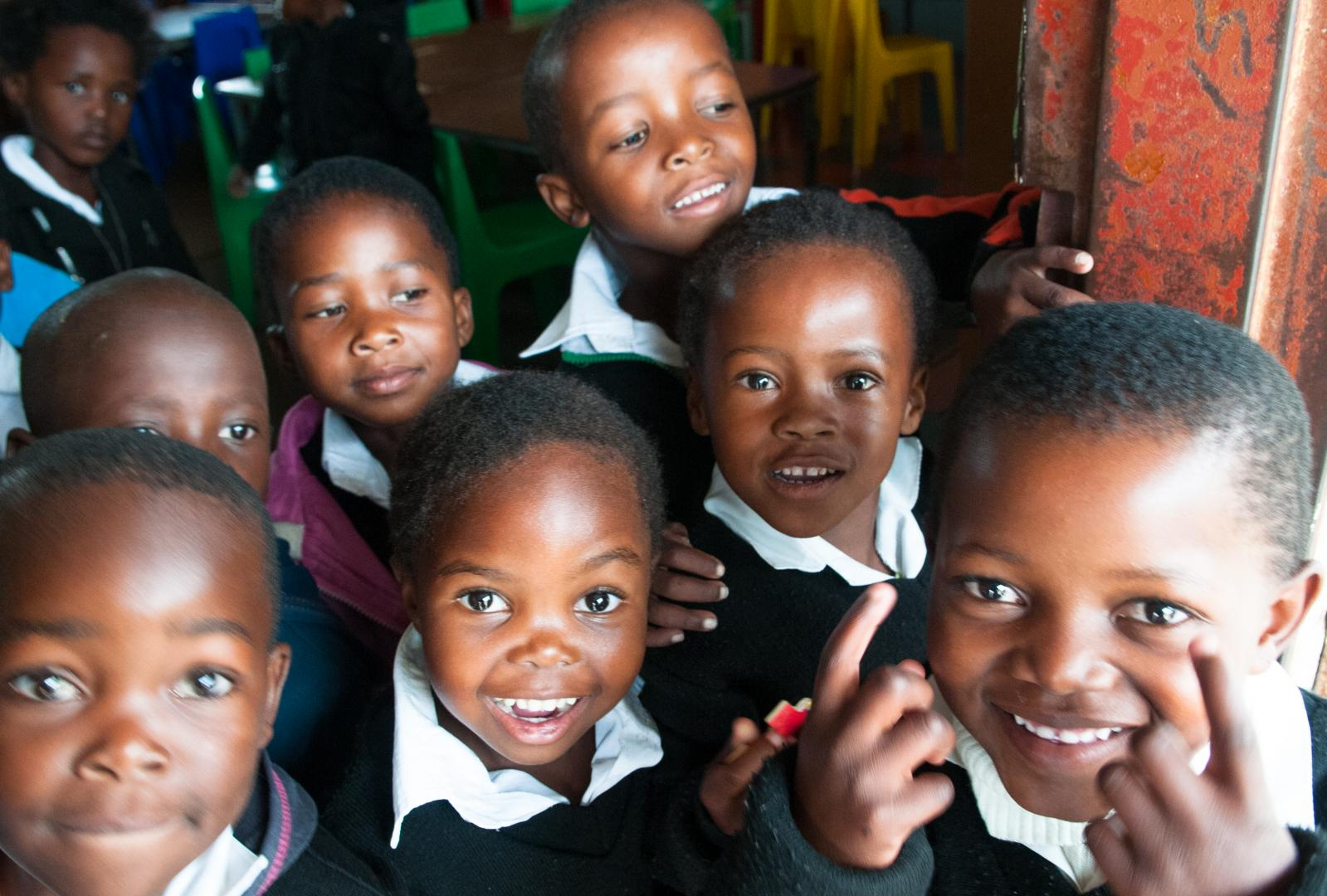 Zenande, 5 years old (in the middle), and her classmates have just finished a grade 0 class in the Gwebinkunda Primary School situated in the rural part of Eastern Cape, South Africa