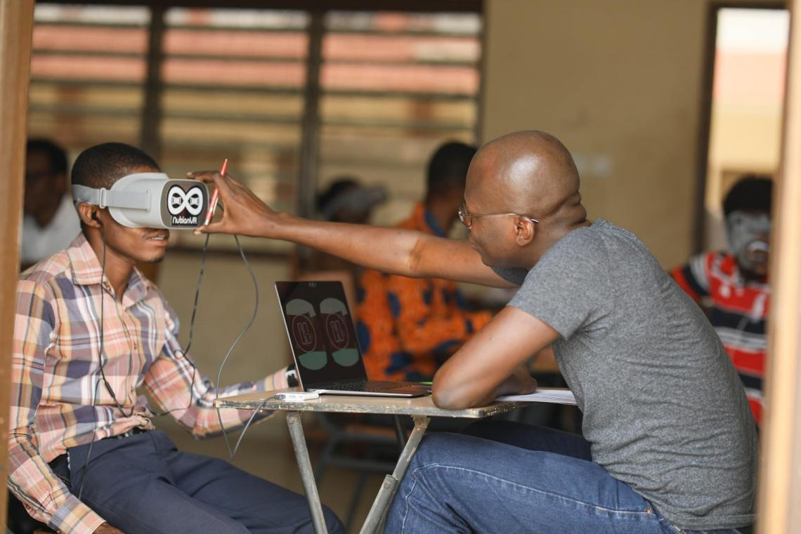 Kabiru Seidu (right), co-founder of NubianVR, demonstrating VR technology with one of the educators in Ga-East District.