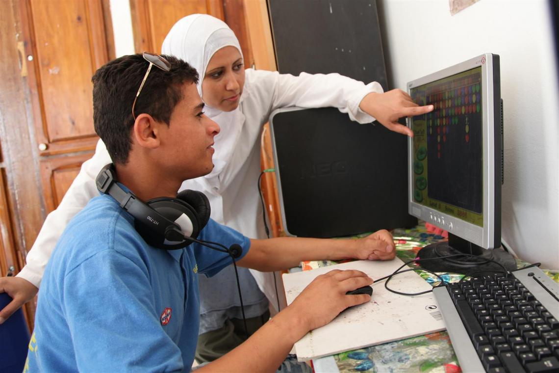An instructor explaining a module to a student