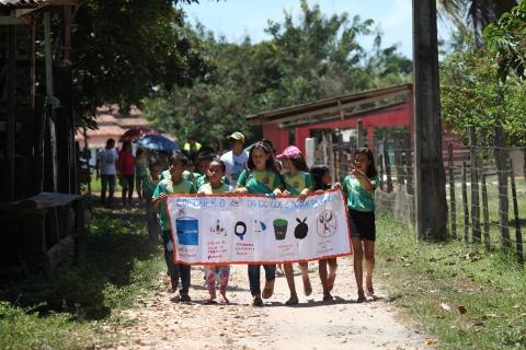 Young girls advocating, holding a banner with message